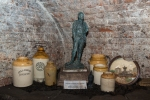 Various large jars, alongside the statue of Joseph Williamson