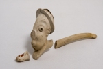 A Clay Pipe, modeled on the character, Ally Sloper. The pipe is in 3 pieces, but othervise complete